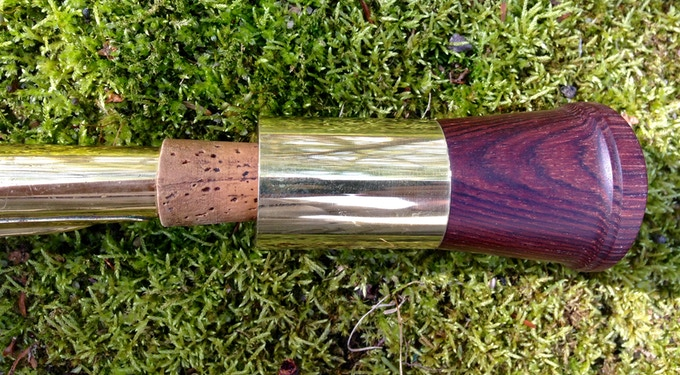 Rosewood on a bari sax. The brass ring will be silver plated in production.
