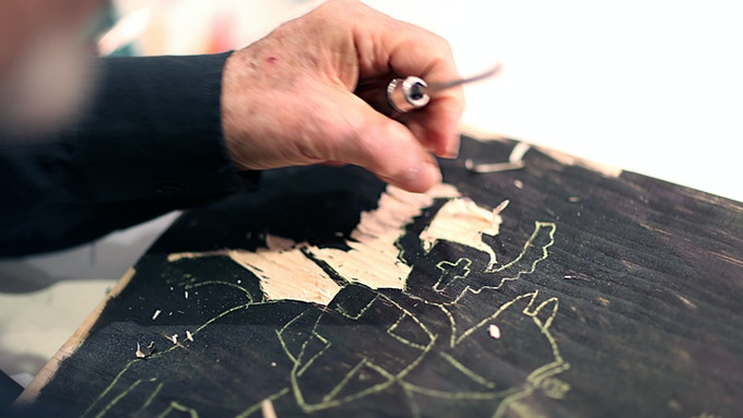 """Seymour Chwast working on a woodcut illustration of Teutonic knights conquering Prussia, 1283, from """"At War with War."""""""