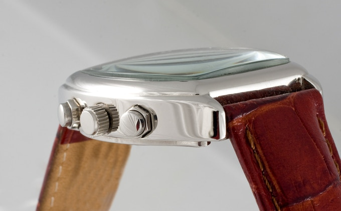 """6798f963303 The Stainless-steel rear case is engraved with the manufacturer s brand """"WM  of Switzerland""""."""