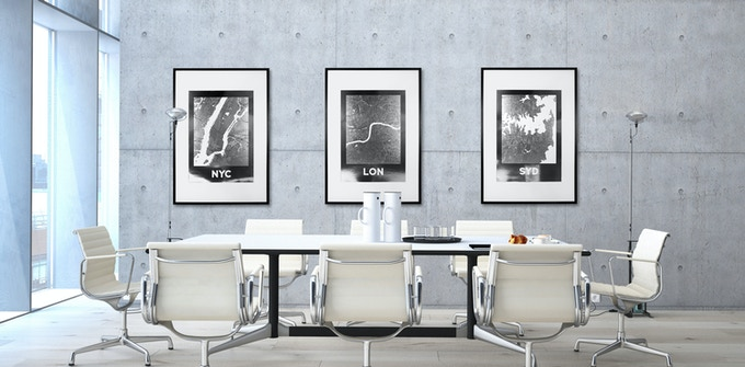Create an urban feel with silver reflective city map posters in your office.