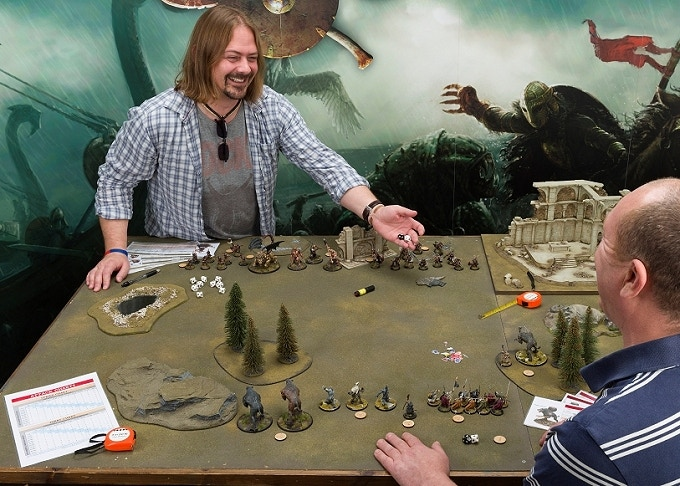 Two young happy fellows enjoying a game of Darklands!