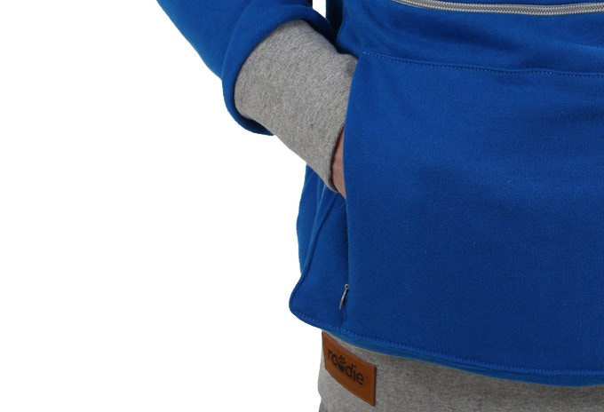Features: Hidden side pockets separate from the main inner pouch.