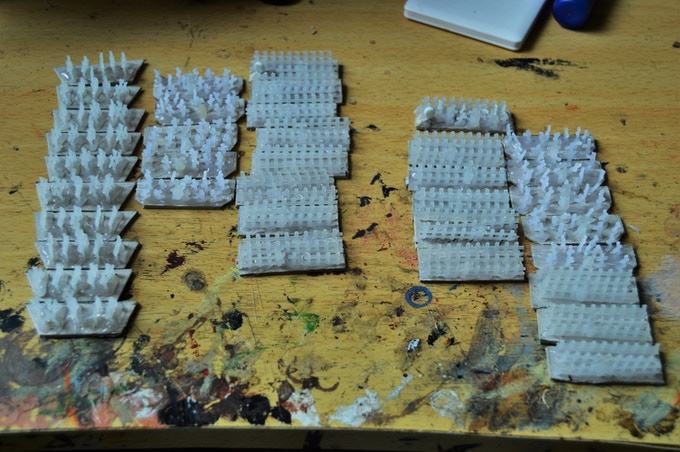 "Two unpainted ""Granny grating"" armies."