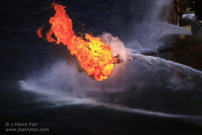 Flare on drill rig burning what gases are captured from the leaking well a mile below the surface.
