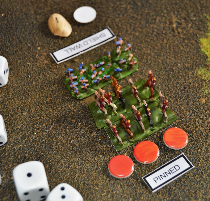 """A unit of pinned (under flame ammo fire) Roman cavalry fights a """"shielding"""" unit of Celtic woad warriors."""