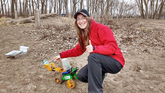 Erin celebrating the robot capturing debris