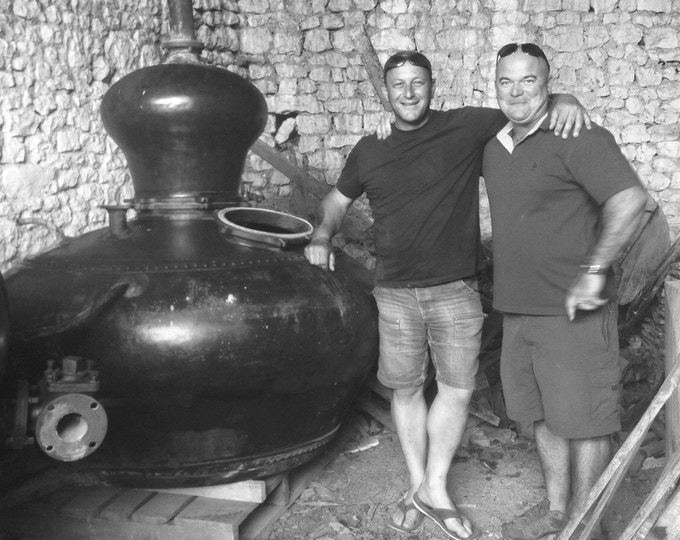 Our copper cognac still, hand beaten in 1966. Founder Greg Millar on the left with the previous owner in France.