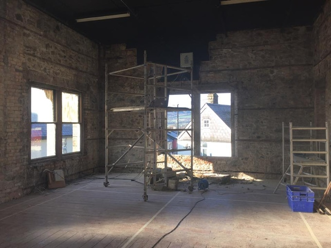 The photo depicts the distillation area and no one has looked out of the windows in the image above for more than 50 years