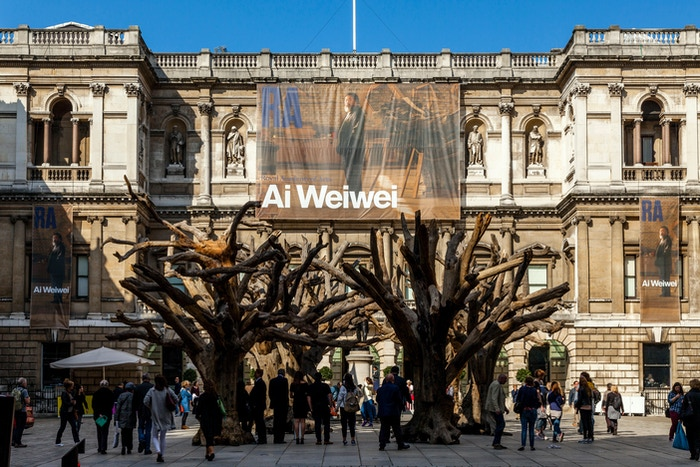"Patrons explore Ai Weiwei's Kickstarter-funded ""Trees"" exhibit at The Royal Academy."