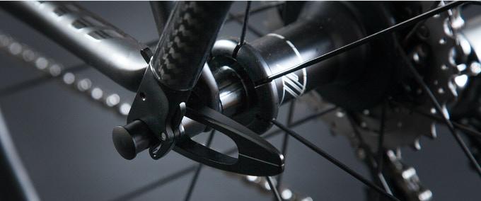 Rack to quick release skewer connection - bike with rim brakes