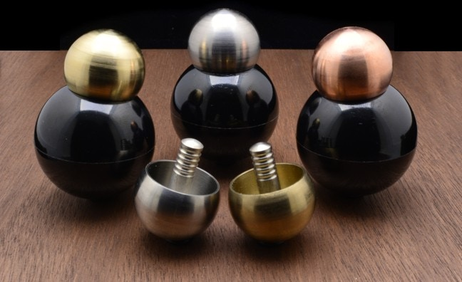 Spice up your desk space with a black spherical Tippe Top holder.
