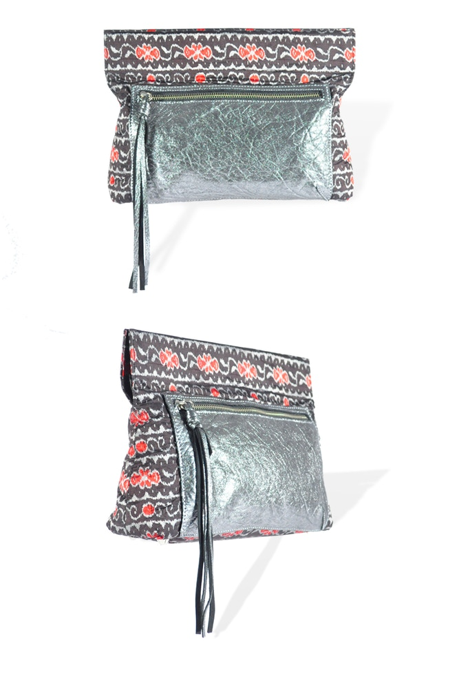 The Maya clutch in black ikat with metallic leather trim