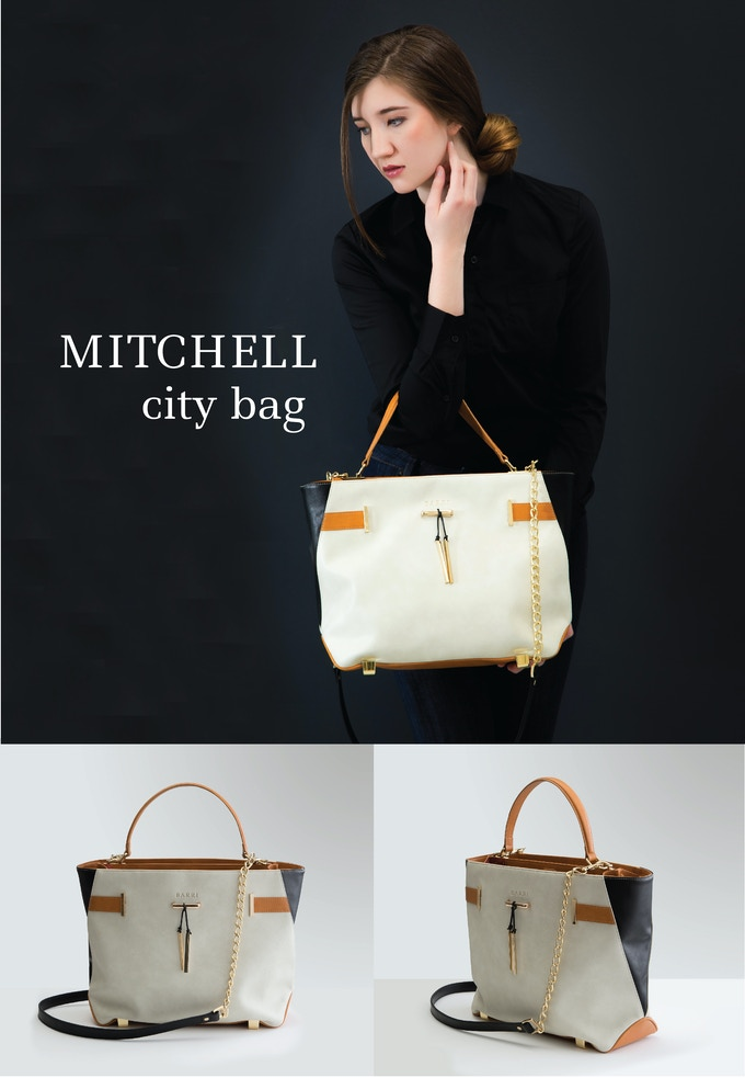 MITCHELL CITY BAG: Sophistication at its finest. Turn heads with this stunning take on a neutral colorblock bag. Cream vegan leather paired with camel and black accents and gold hardware give this back a rich look. See rewards section for more details.
