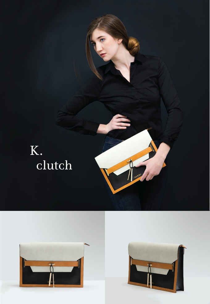 K. CLUTCH: Be daring and get noticed with this stunning take on a neutral colorblock oversized clutch.  Cream vegan leather paired with camel and black accents and gold hardware give  this clutch a high fashion look. See rewards section for more details.