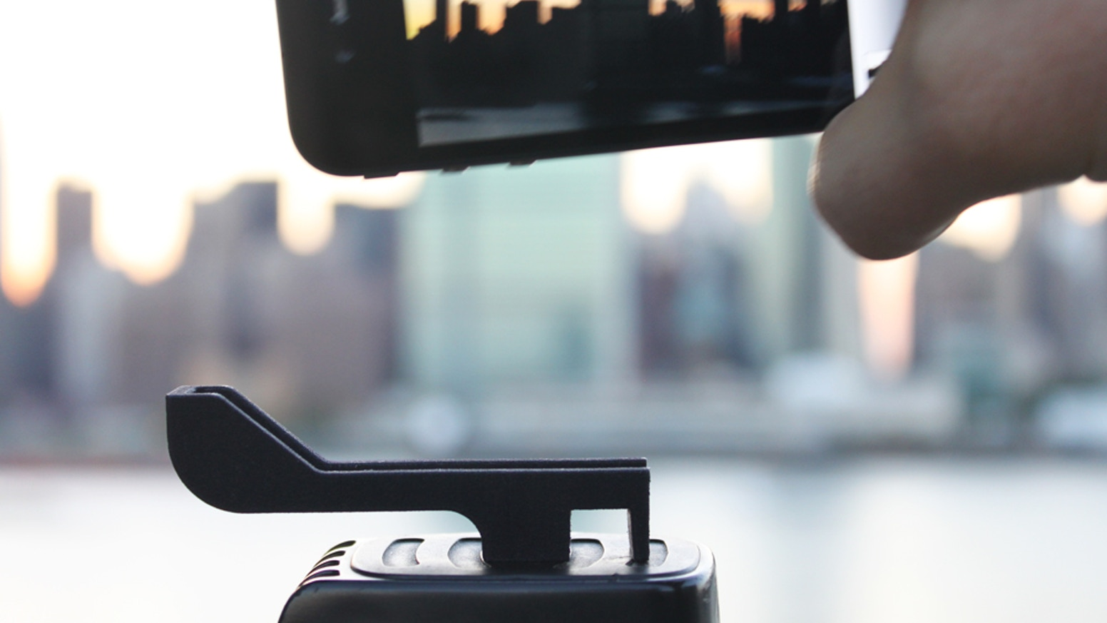 Glif is a simple accessory with two primary functions: mounting your smartphone to a standard tripod, and acting as a kickstand to prop it up.