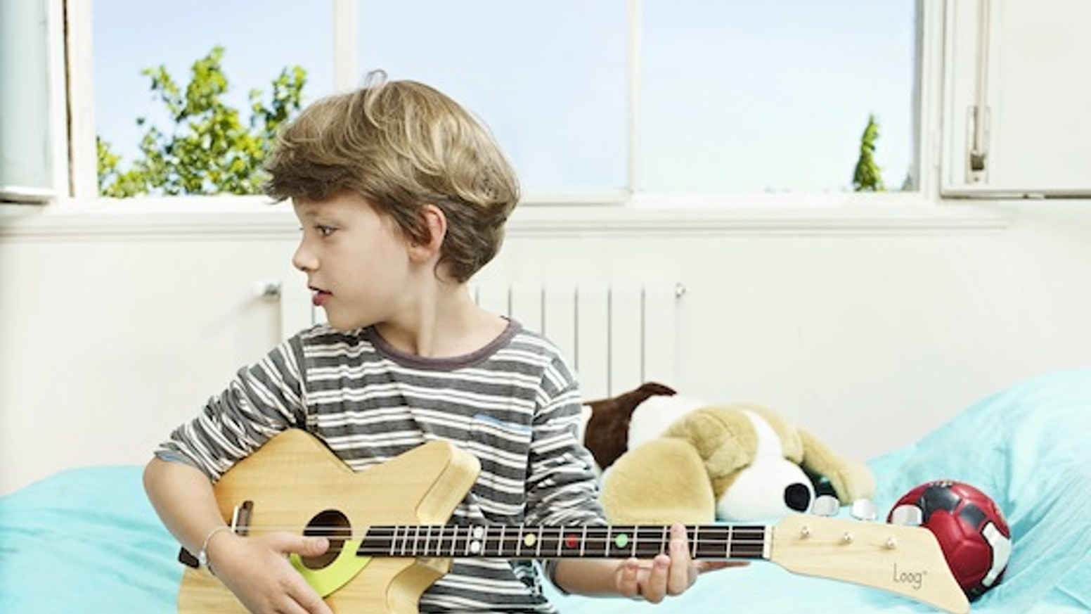 Loog Guitars is a line of small, 3-string guitars designed to make it fun and easy for kids to play music.
