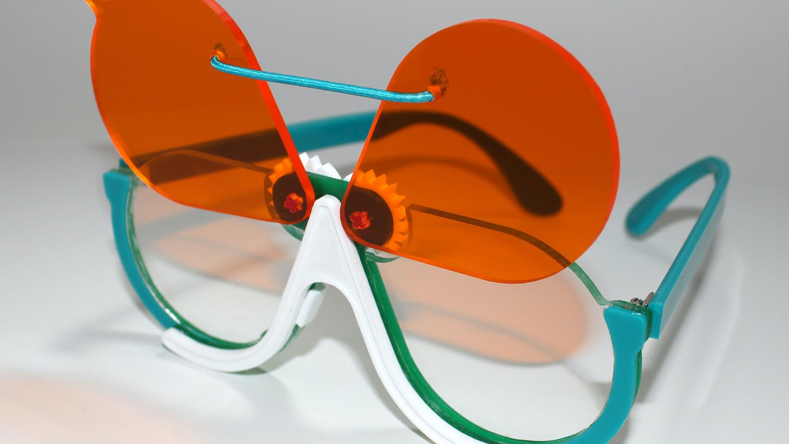 3079fa7051 two lenses are better than one! glasses that flip with just a flick.  sunglass or diffraction.