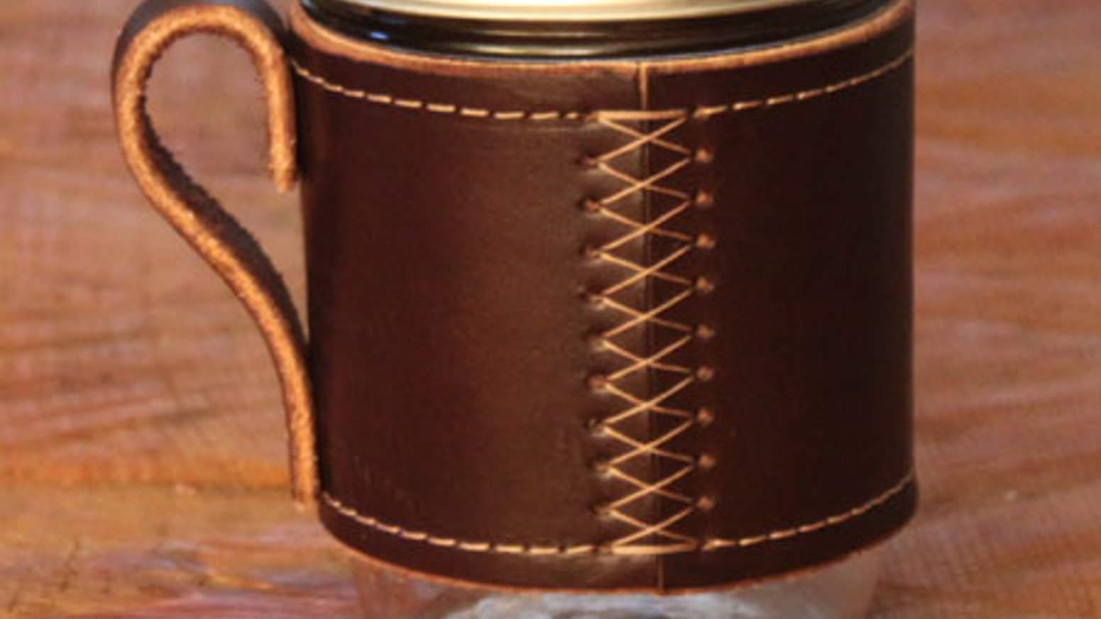 The Holdster converts mason jars into sexy, leather-bound mugs.  Your beverage has never looked so good.