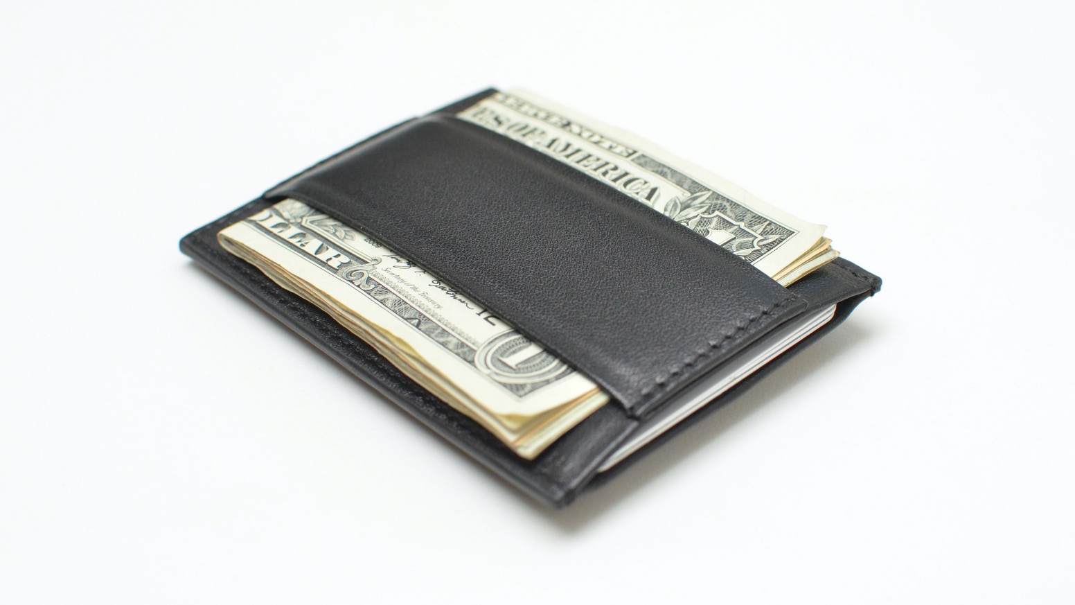 A re-imagined super-thin card-case style wallet crafted for the design conscious minimalist.