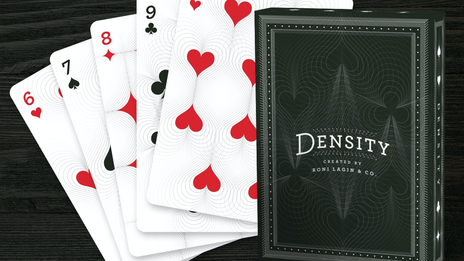 Limited edition custom-designed deck of playing cards where suit symbols are manipulated into intersecting shapes and patterns.
