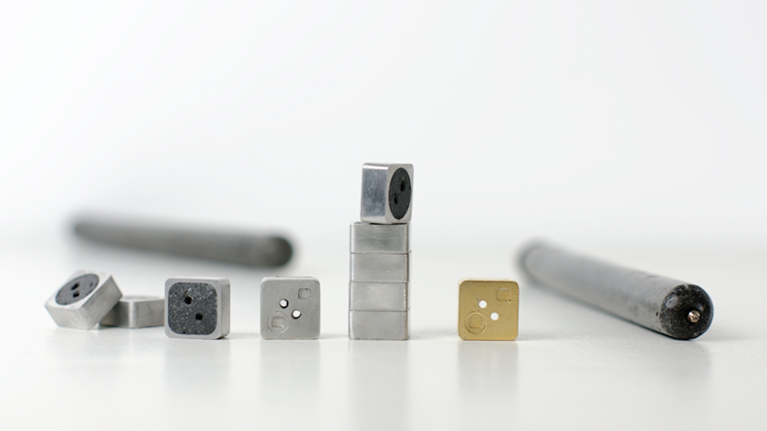 An Artisan Production of Engineered Concrete Pens, Buttons, & Cases.