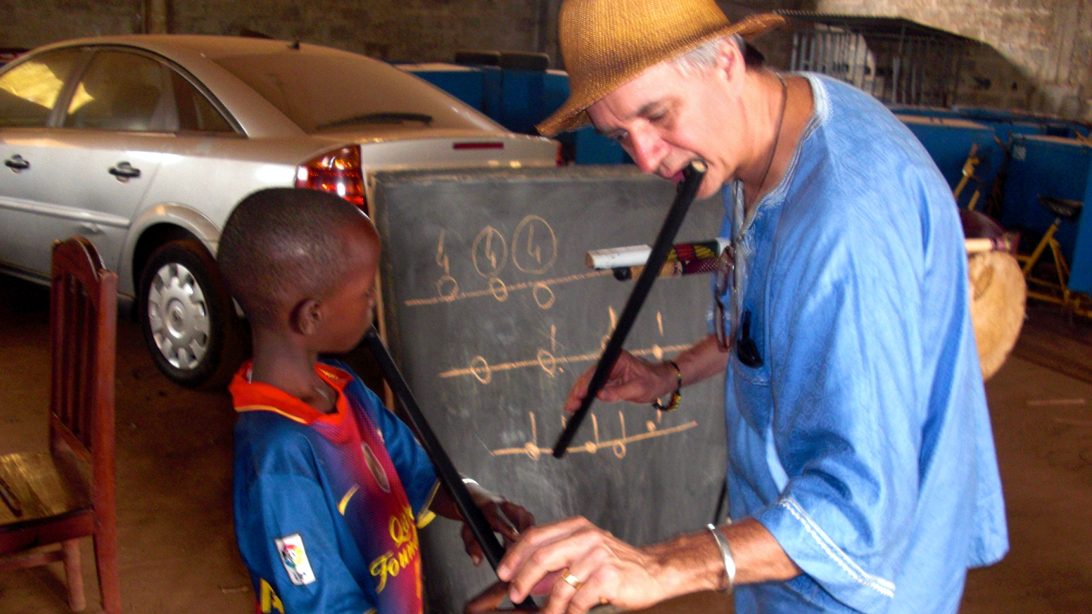 """Conduct and document a semester of an exploratory program in Guinea made possible by the new 6-hole """"chromatic tambin"""" flute"""