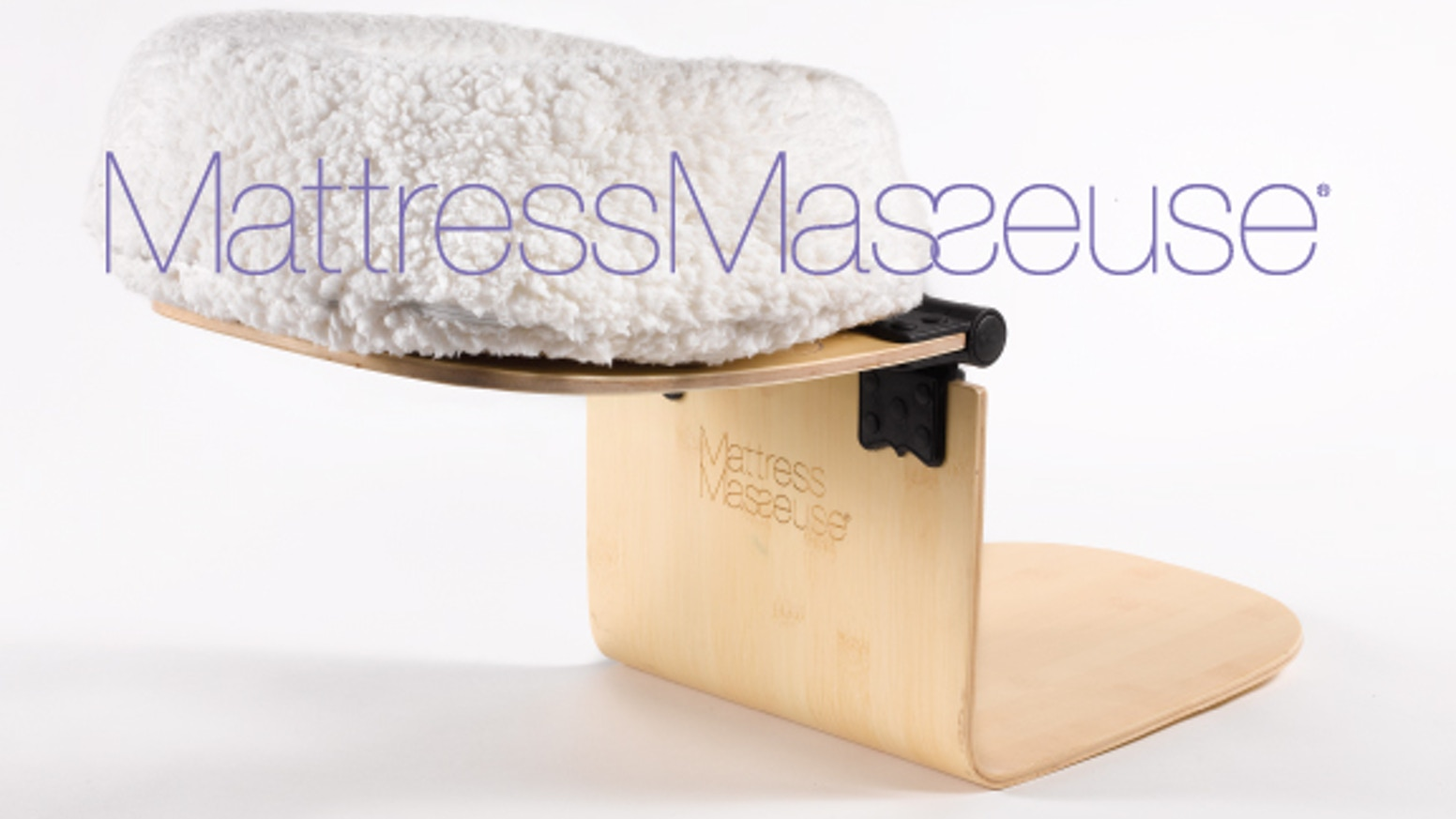 The massage table headrest for your bed.