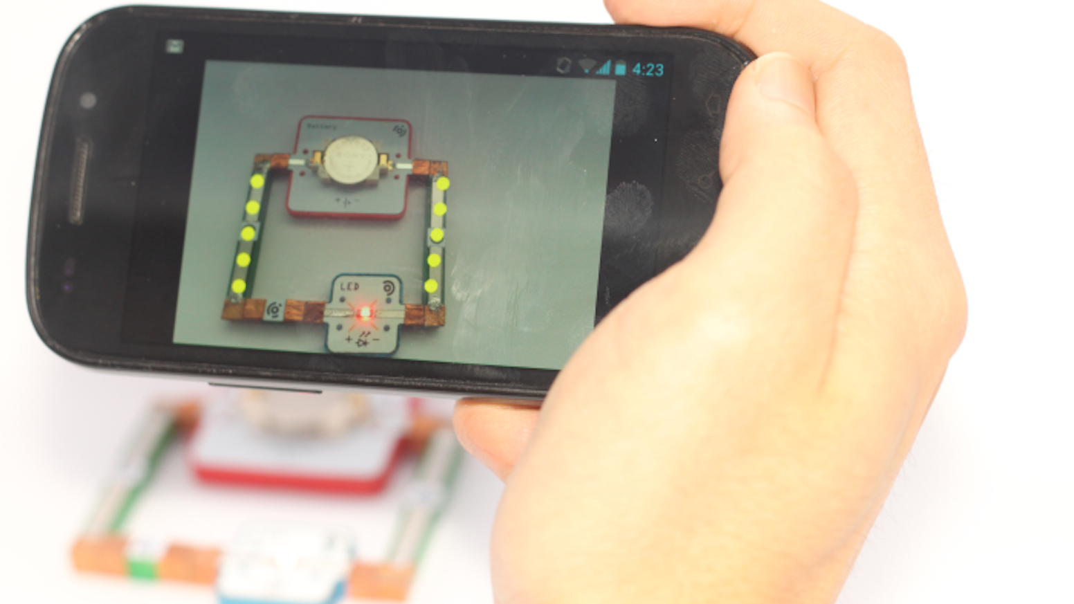 Kids learn electronics by building projects: combines electronic building blocks with the first-ever augmented reality tutor app.