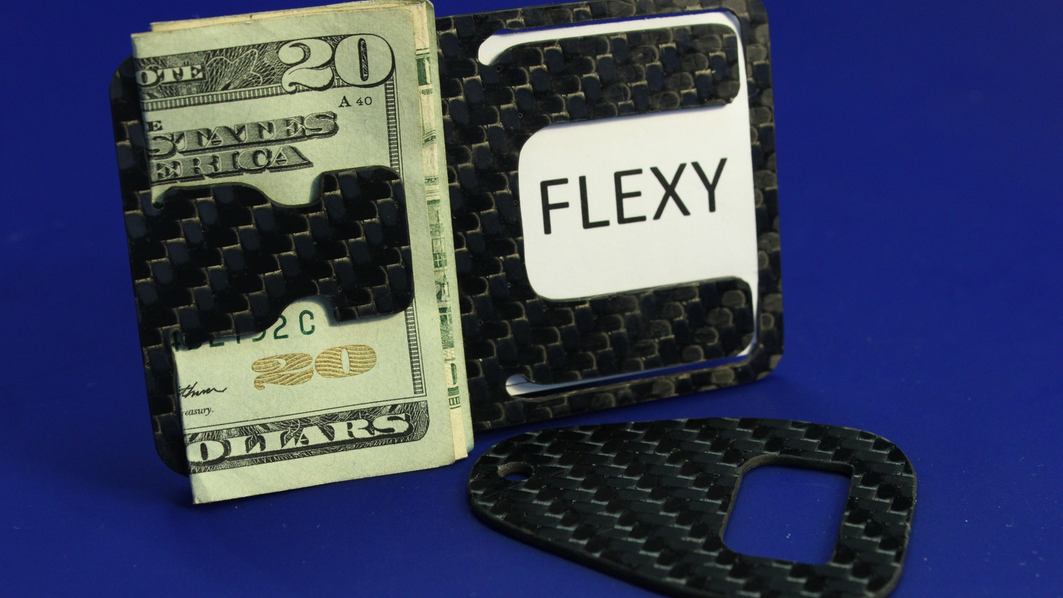 A minimalist clip that organizes your cash and cards. Made in the USA out of Carbon Fiber, and it opens beer!