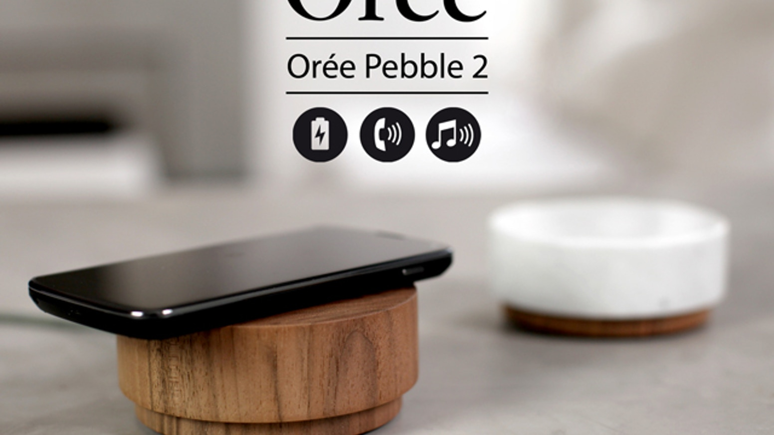 A smartphone wireless charger +  360° Bluetooth speaker and mic in a single block of premium artisanally crafted, solid wood or marble