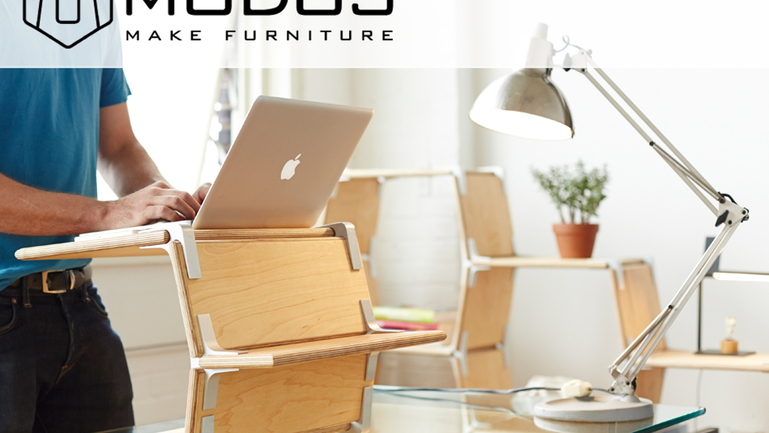 Modos is a modular furniture system that uses connectors and boards to make desks, shelves, standing desks, media centers or anything you want.