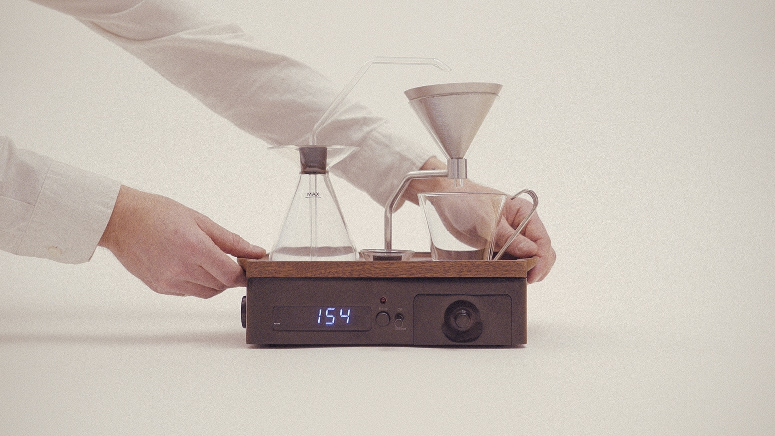 A beautifully designed alarm clock in high-end materials, waking you with freshly brewed coffee or tea.