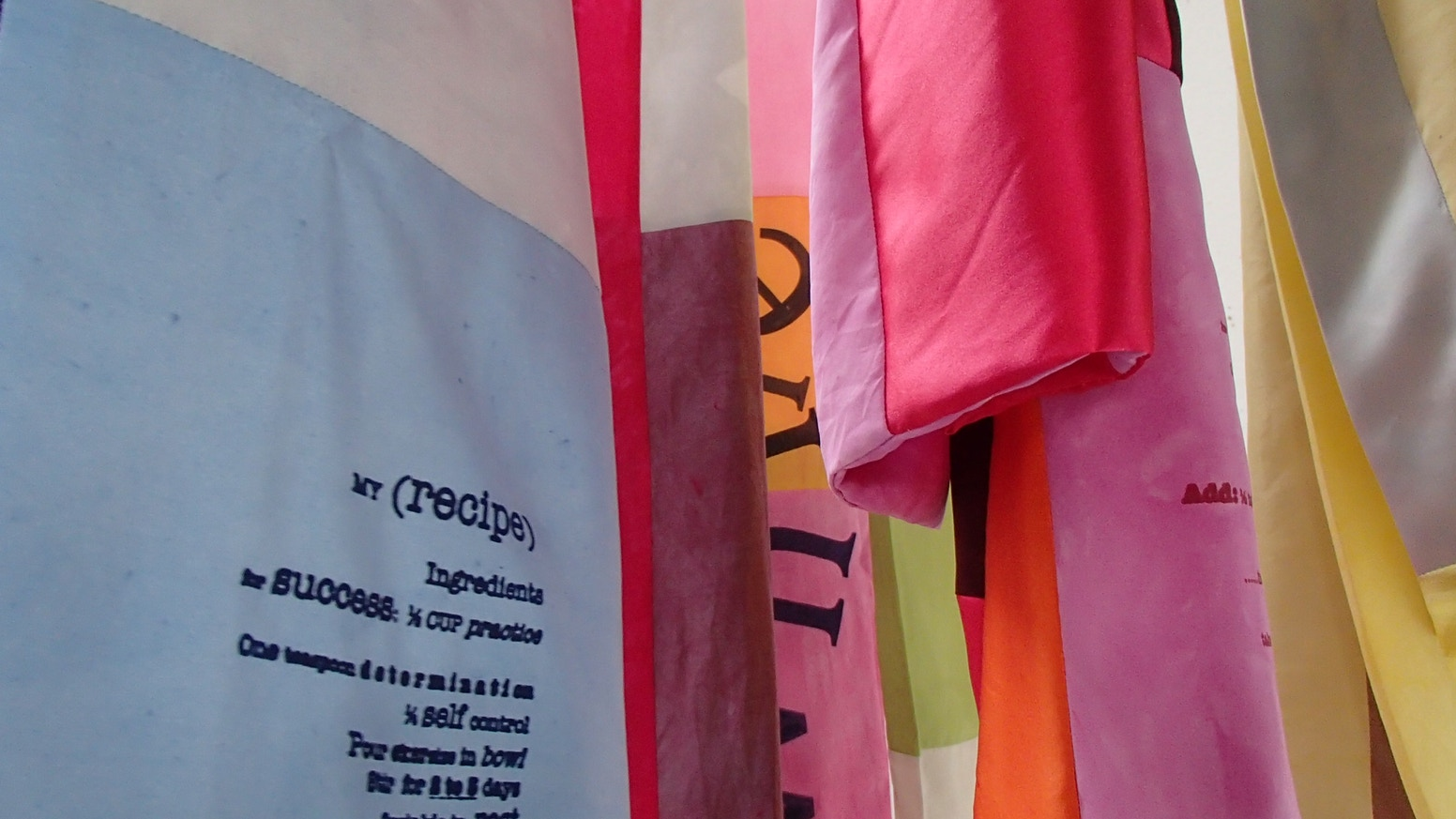linking text with textile through community action = creating 200 hand printed & dyed silk scarves with/for cancer community