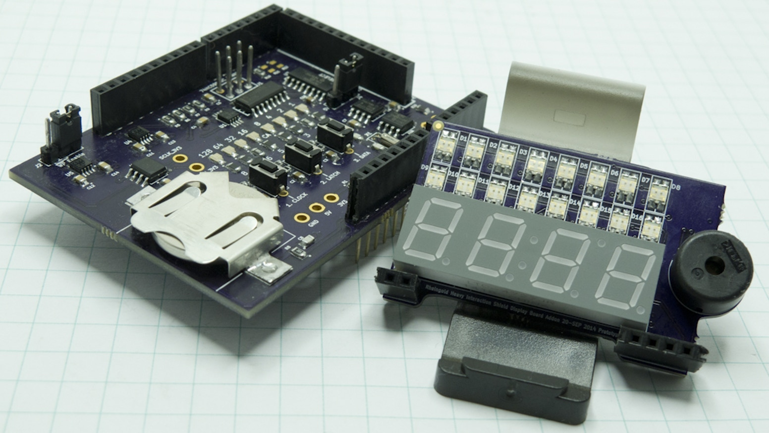 An Arduino compatible shield matched with a web based tutorial system to teach you how to talk with I2C and SPI components.