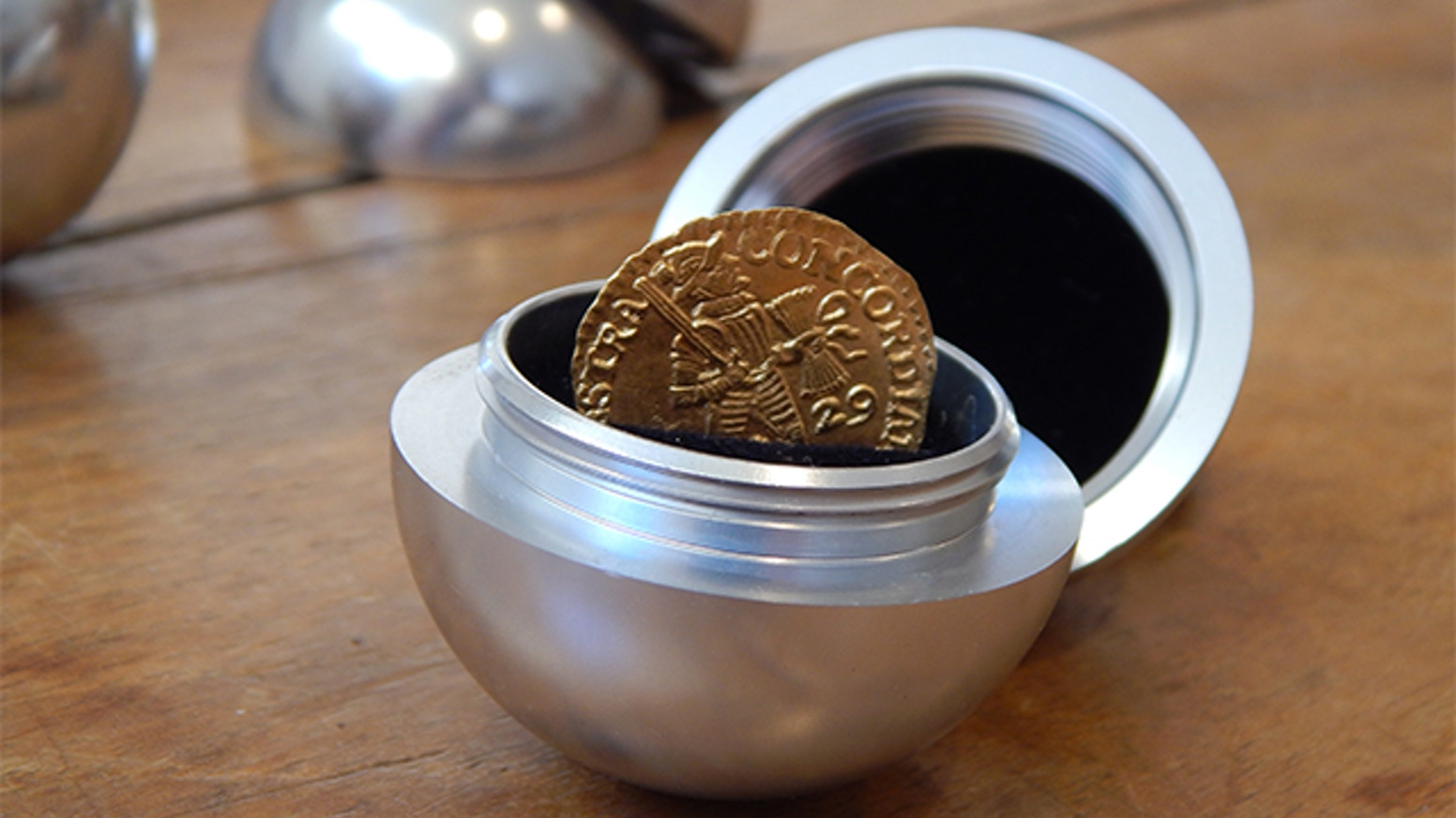 The Orb is a unique precision machined spherical keepsake container.