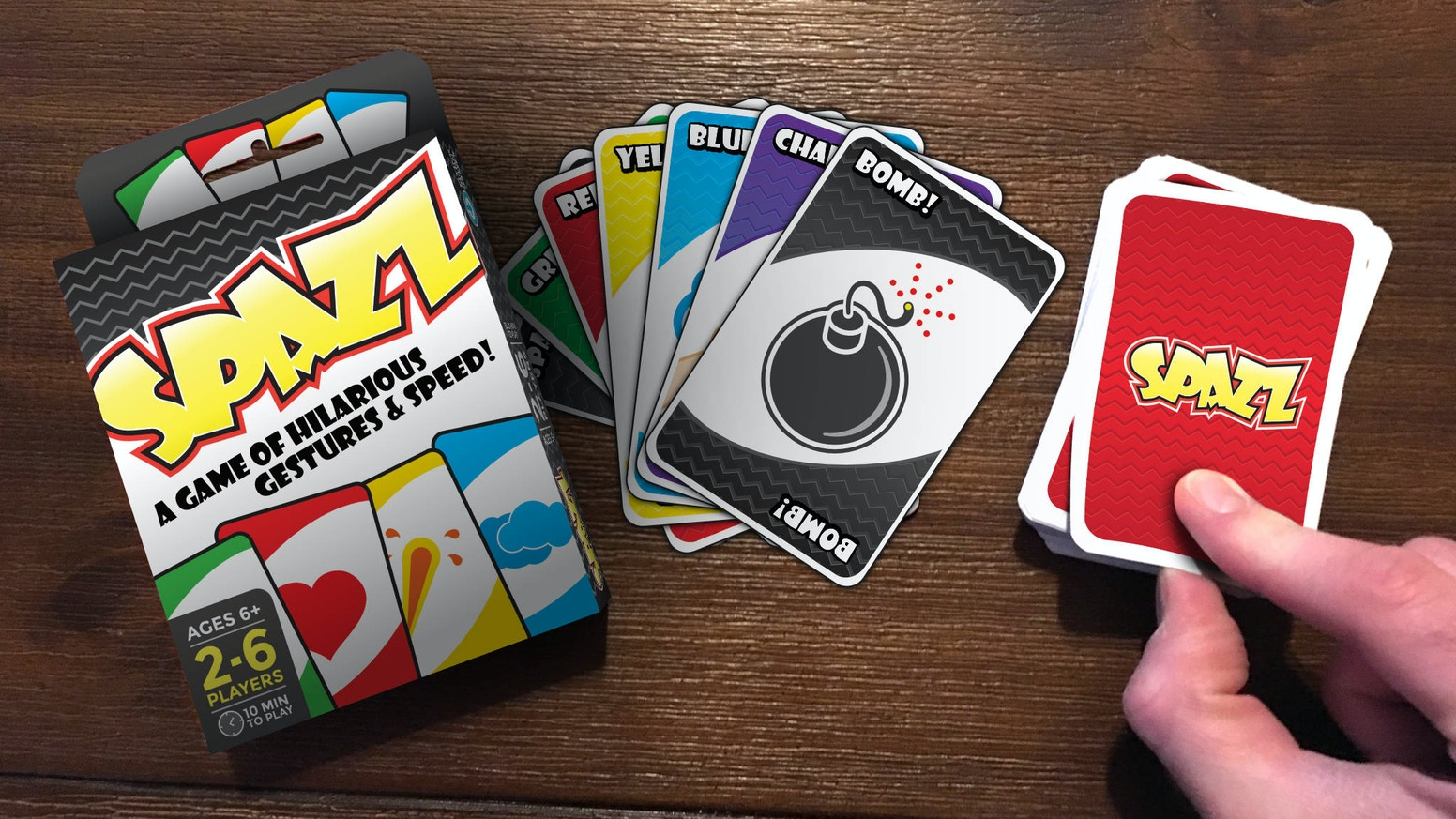 Spazz is a card game that combines speed, hilarious gestures, and your silly side for 2-6 players, ages 6+.
