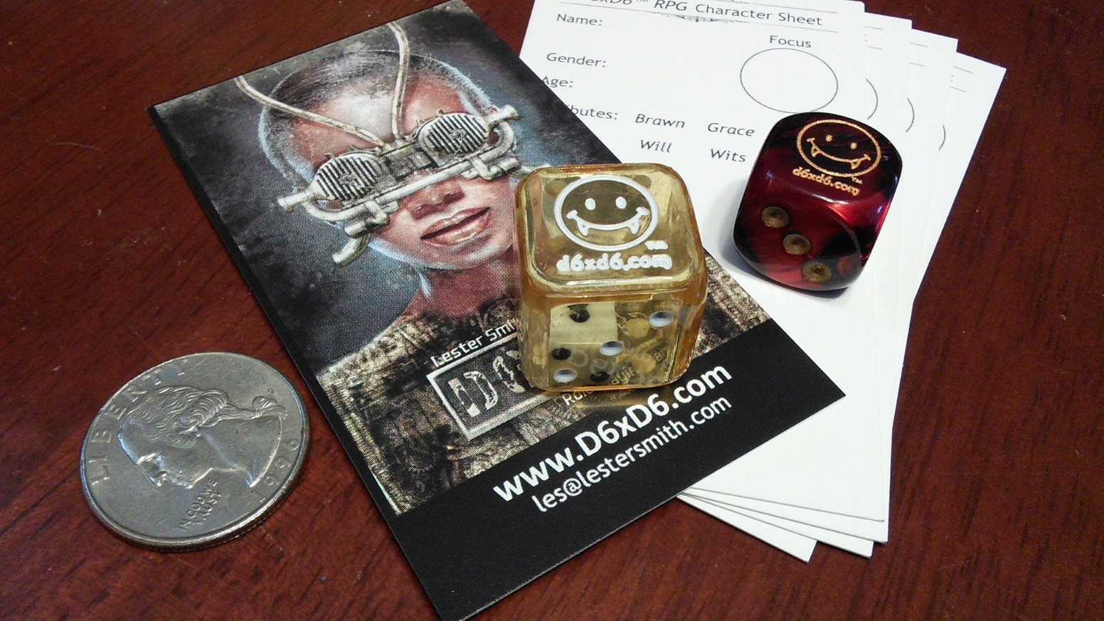 "Missed the Kickstarter? Get a ""D6xD6 Playpack"" of 5 Fanged Smiley D6xD6 Doubledice and 25 Biz Card PC Sheets here!"