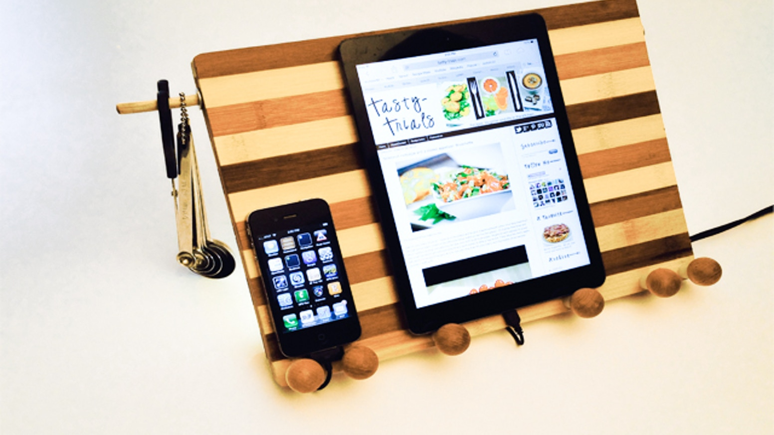 Cool tablet and cookbook stand made out of eco-friendly bamboo designed  perfectly for charging devices while in use in your kitchen.