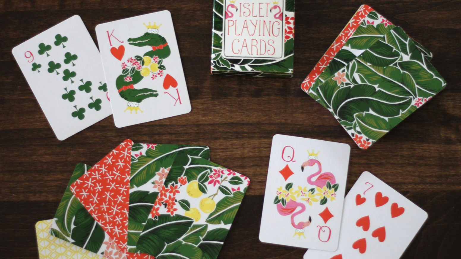 Original hand-painted illustrated deck of playing cards with queen flamingos, king alligators, banana leaves and geometric patterns.