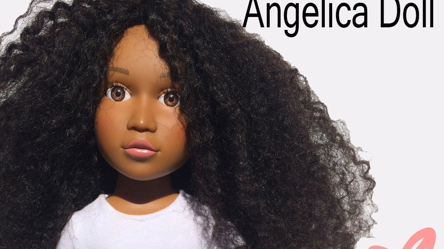 Finally, a beautiful 18-inch vinyl doll with facial features true to women of color and hair you can style/wash as natural hair.