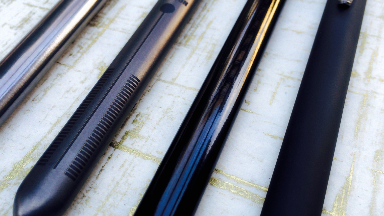 Oval Bolt Pen - slim and elegant - unique shape that allows the bolt to stay flush with the pen body - every part Titanium. (Pat Pen)