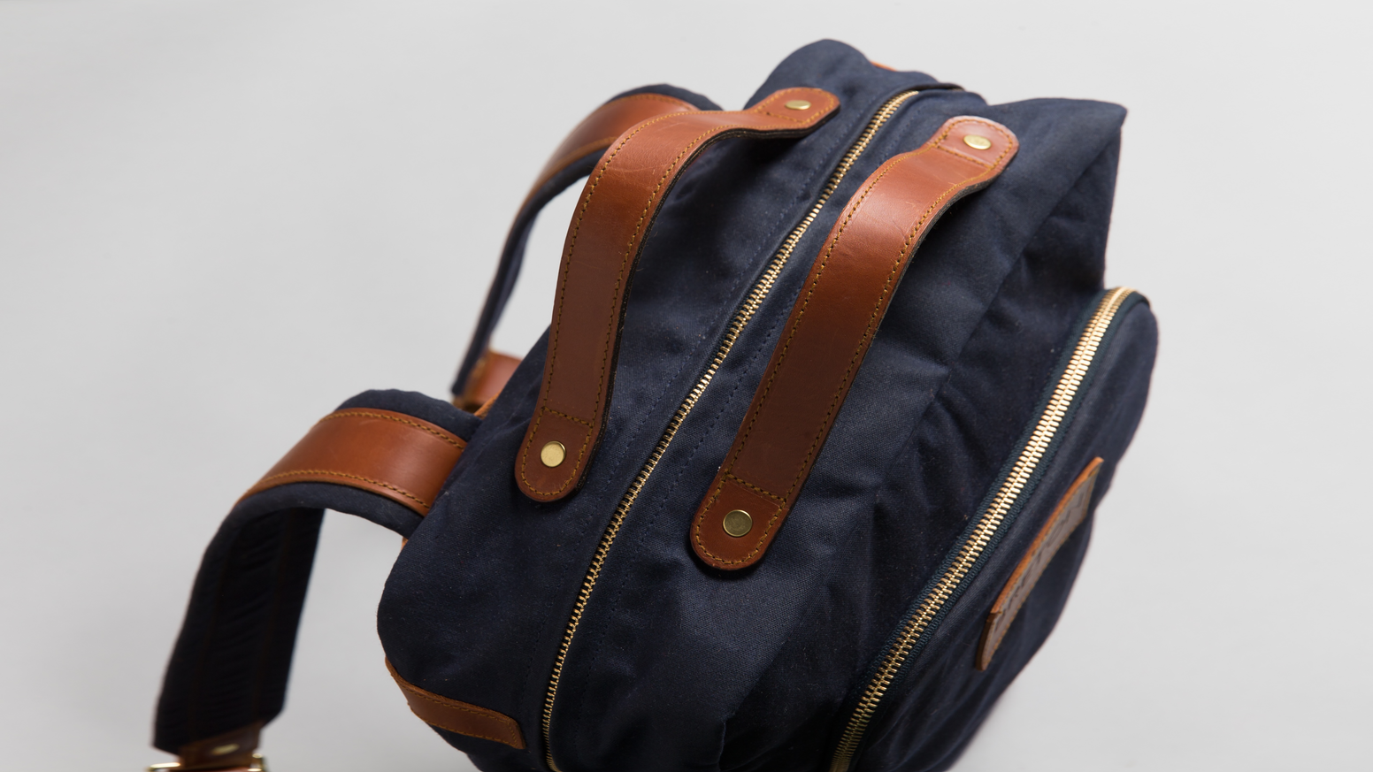 A bag for the modern professional, combining the comfort and convenience of a backpack, with the style and look of a high-end satchel.