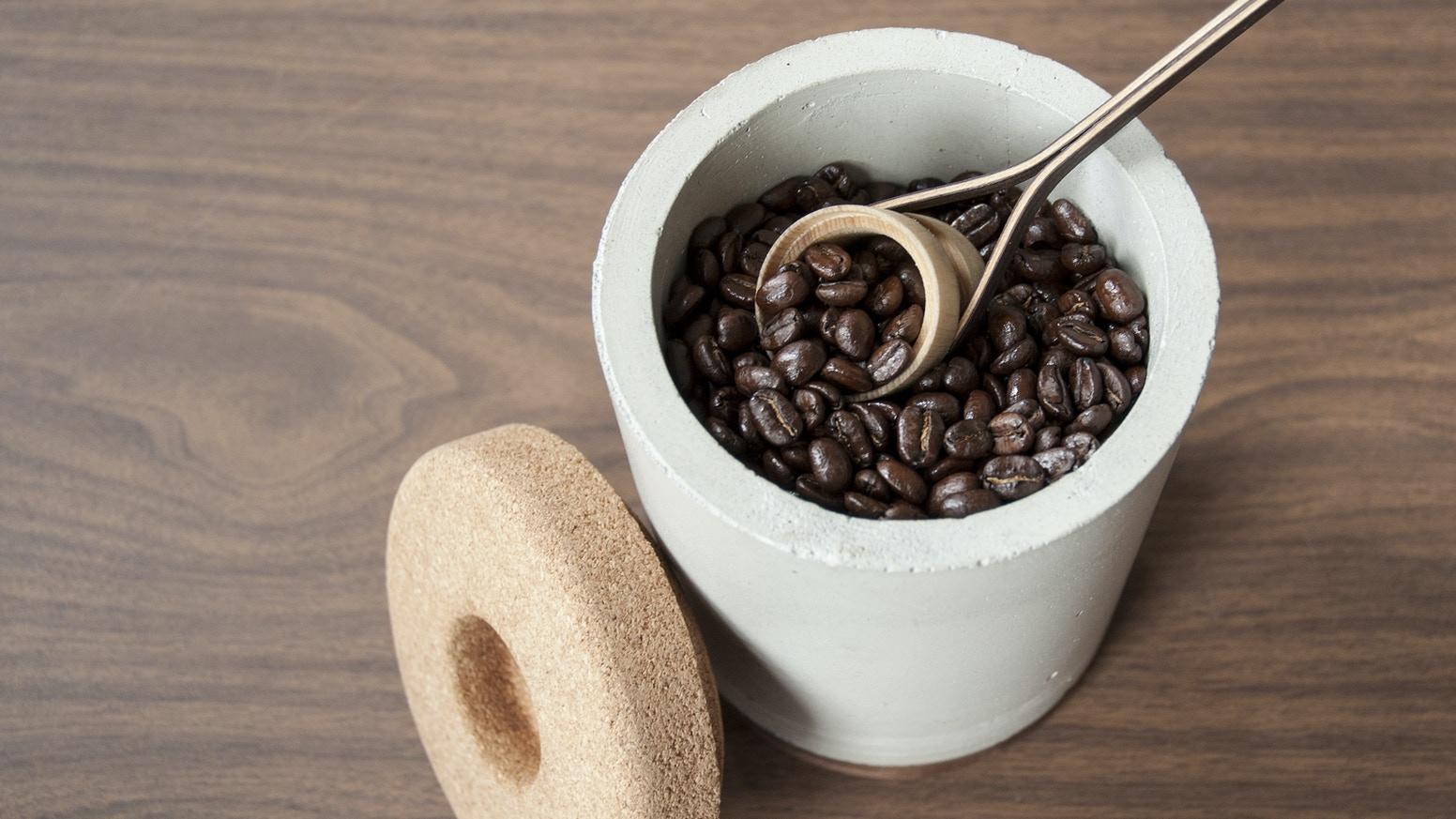 A modern storage vessel designed to preserve coffee in an optimal environment.