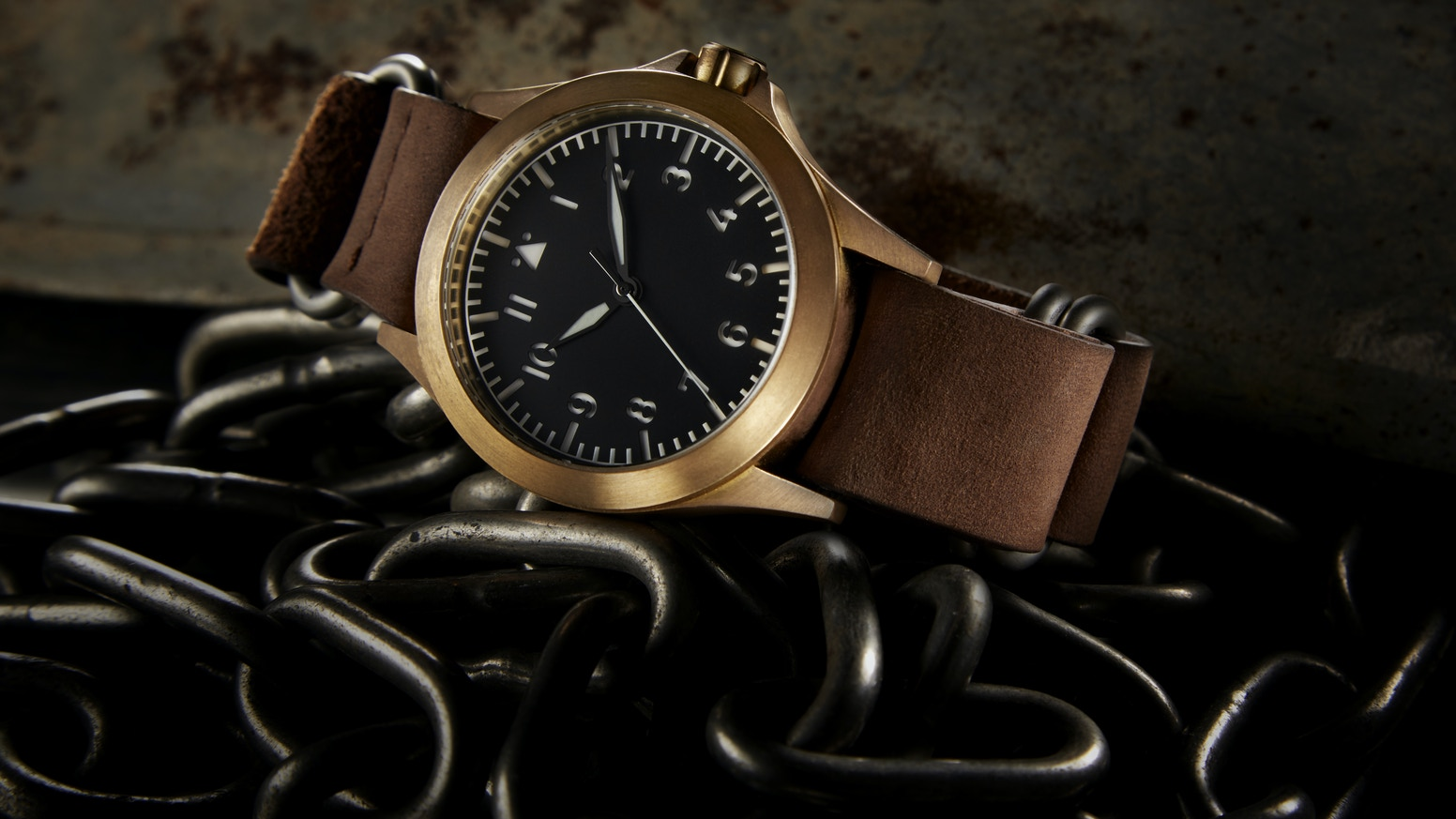 A reinterpretation of the classic WW2 pilot's watch. Crafted from brass which develops a patina unique to you.