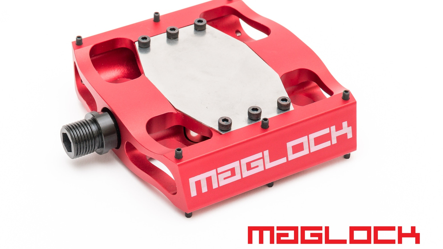 """You Rule Your Bike"" with magnetically clipping bike pedals that make clipping in and out safe and easy."