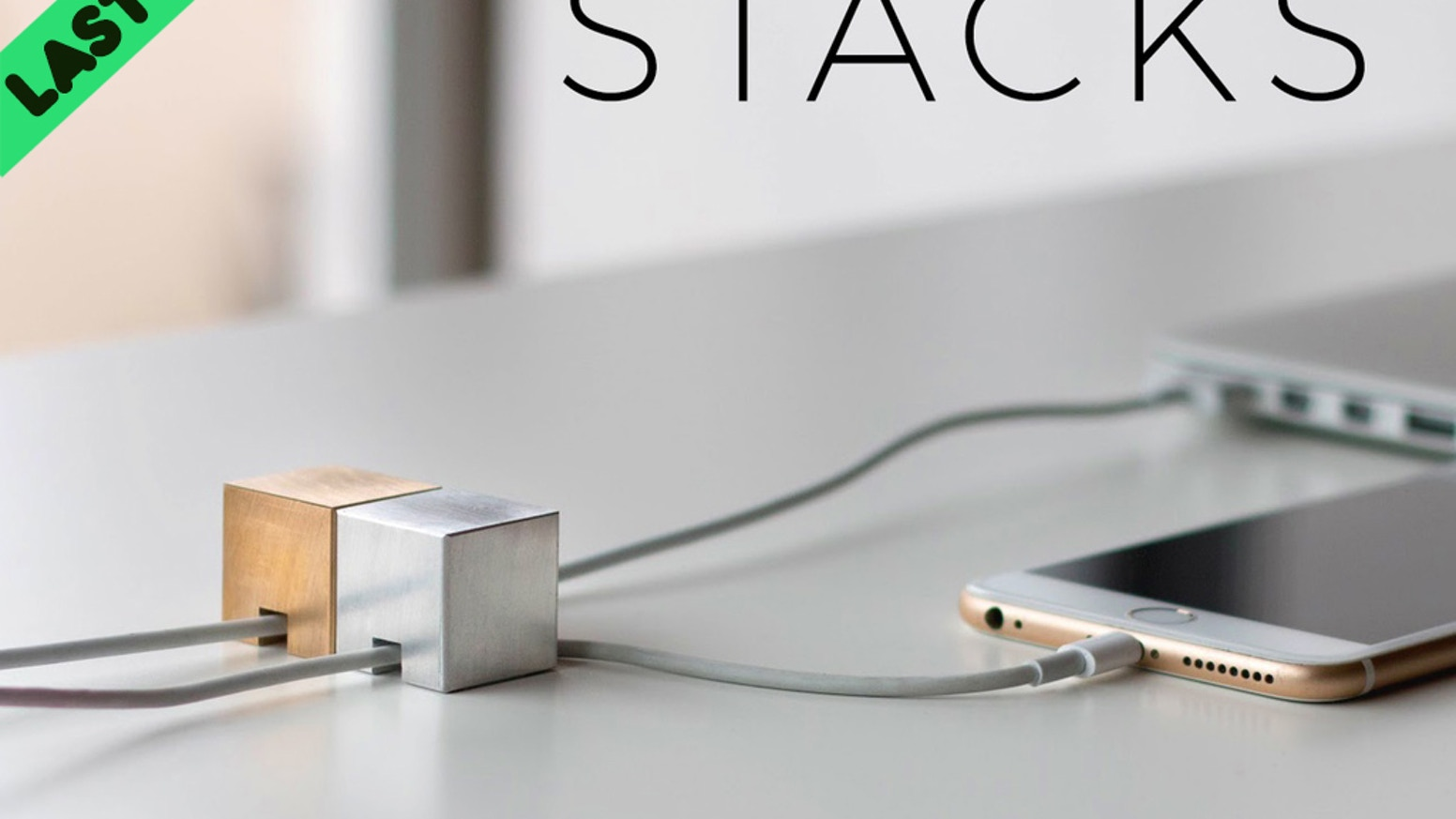 Beautiful industrial steel & brass art used to organize cords/cables.  Premium desk accessories