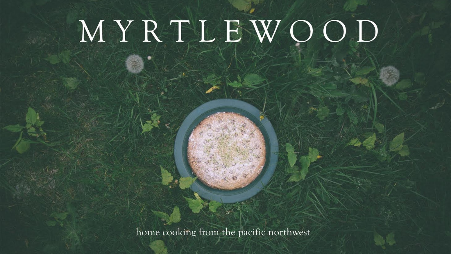 A cookbook created in a home kitchen, using ingredients from a backyard garden, farmer's markets, and small shops.