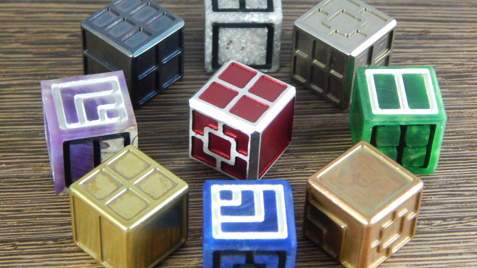 New take on the D6. Now with 2 designs! Available in Acrylic, Stone, Wood/Acrylic, Aluminium, Brass, Copper, Titanium & Tungsten
