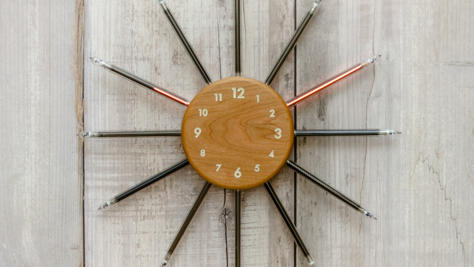 Nixie Radian is the ultimate in modern style - a wall clock using vintage linear indicators.  The world's first analog nixie timepiece.