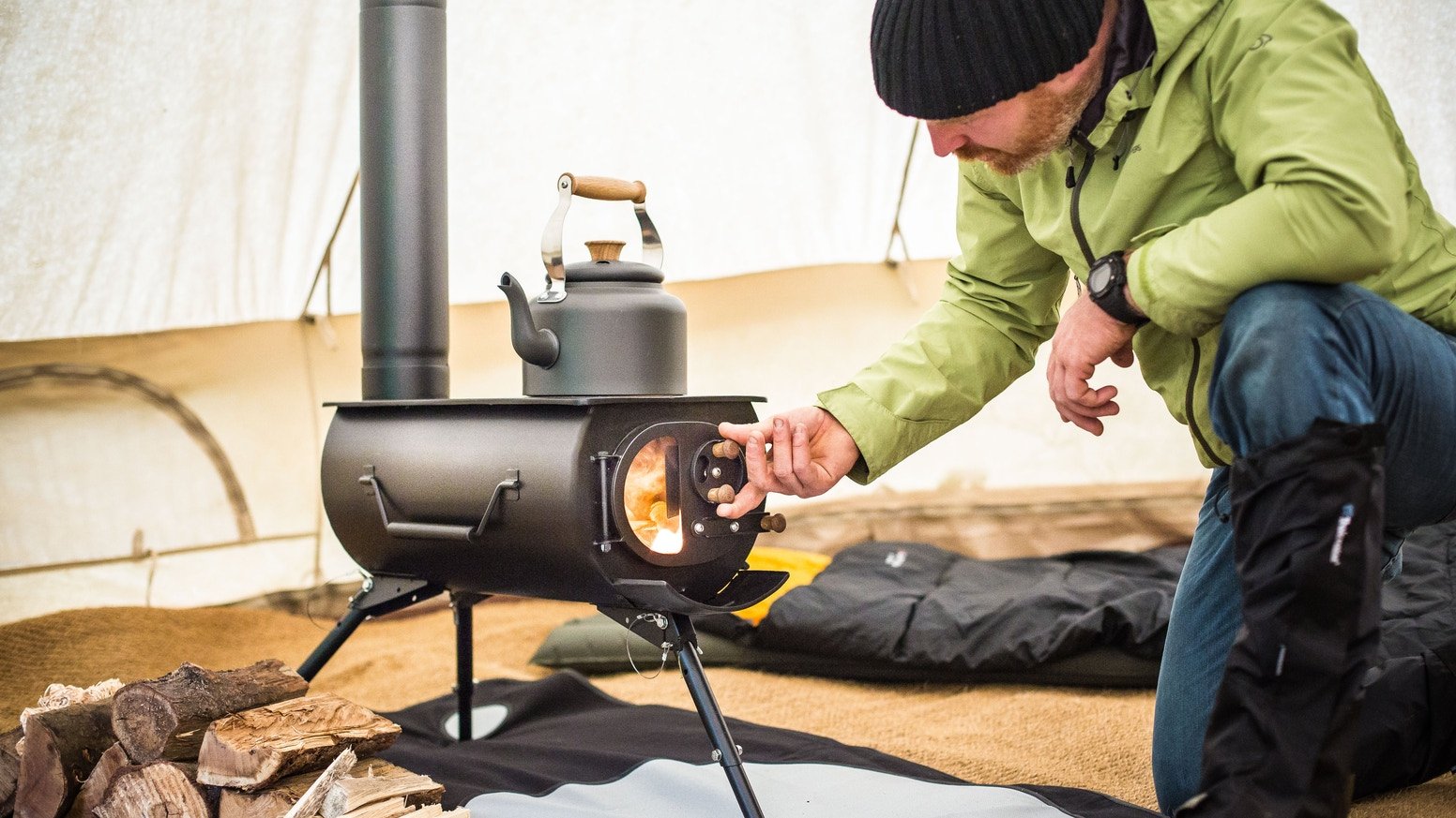 A Lightweight Folding Stove With Flue For Heating And Cooking In Tents Sheds